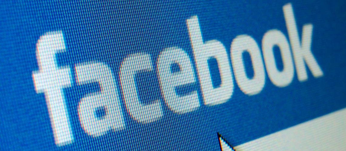 WARSAW, POLAND - APRIL 23: Close up of an LCD screen showing the Facebook logo on the original blue background. Facebook.com is the largest social networking site in the world with over than 900 million people registered.
