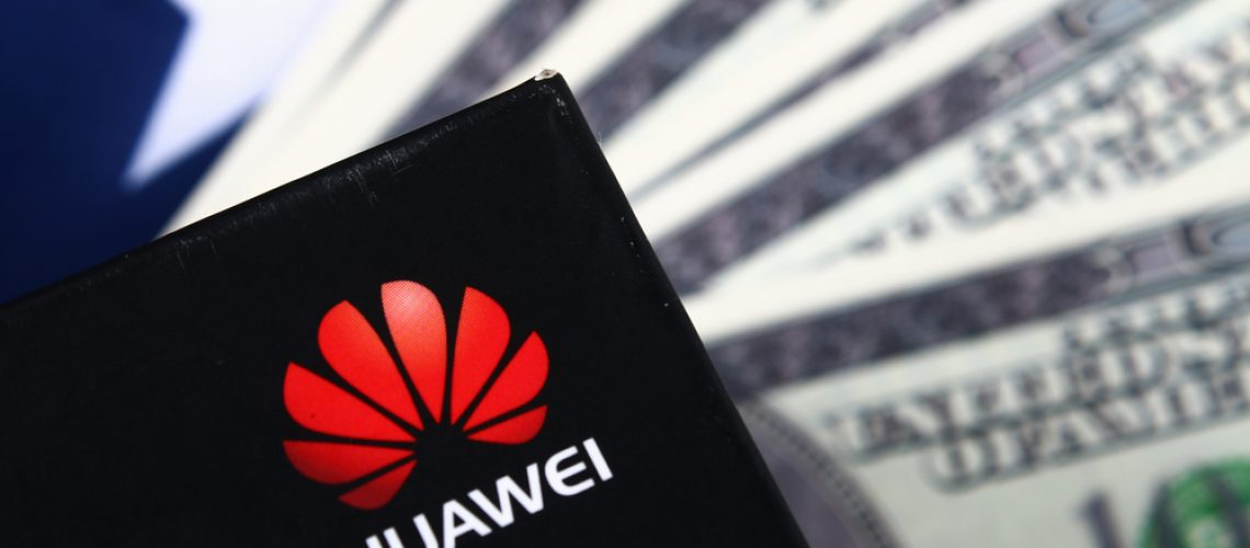 Mobile phone company Huawei on background of flag and USA dollars. The confrontation of countries US-China. Business. Stavropol, June 2019